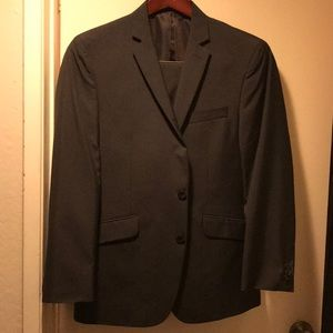 Kenneth Cole suit.